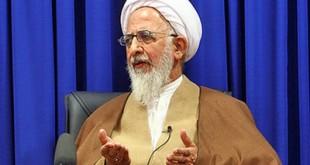 روسری بر سر چوب کردن مقابله با قرآن است